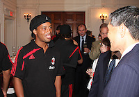 Ronaldinho of AC Milan with DC United owner Will Chang at a reception for AC Milan at DAR Constitution Hall in Washington DC on May 24 2010.