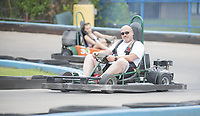 Chris Hetrick of Pea Ridge drives a go cart Thursday July 15, 2021 at Lokomotion Family Fun Park in Fayetteville. Hetrick was racing with his daughter. The National Weather Service is calling for a chance of rain this week with high temperatures in the 80s.  Visit nwaonline.com/21000716Daily/ and nwadg.com/photo. (NWA Democrat-Gazette/J.T. Wampler)