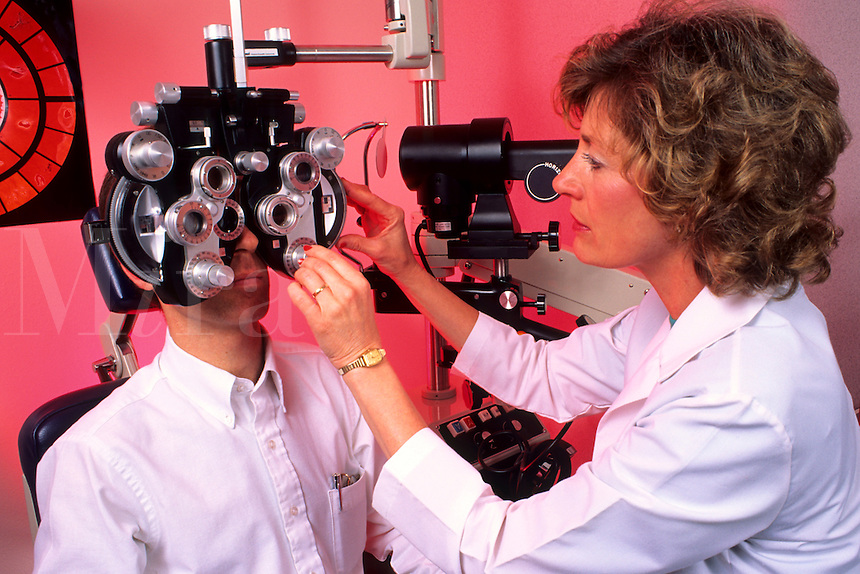 Professional woman optometrist giving eye exam