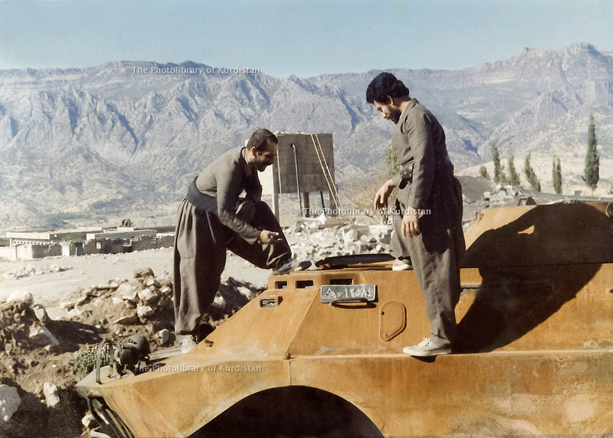 Iraq 1987.In the village of Bala Kadjar,in Qara Dag, 2 peshmergas with an armoured vehicule of the Iraqi army.Irak 1987.Dans le village de Bala Kadjar du Qara Dag, 2 peshmergas sur une automitrailleuse prise a l'armee irakienne