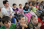 "Schoolchildren watch a performance of the play ""Dwarf"" by the Roma or gypsy theater Romathan at the Banske Elementary School with a Roma or gypsy majority student body in Banske, Slovakia on June 2, 2010."