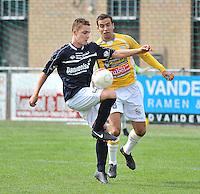 KVC Wingene - KSC Wielsbeke : Bas Vervaeke aan de bal voor de opzittende Vladan Devic (rechts)<br /> foto VDB / Bart Vandenbroucke