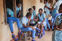 Nigeria. Enugu State. Enugu. Army Day Secondary School ( Awkunanaw in Igbo language). Igbo students outside their classroom. The pupils, boys and girls, wear blue uniforms. They are 15-16 years old. They belong to the class SS2F, Senior Secondary School. The Army Day Secondary School was inaugurated in October 1998. Enugu is the capital of Enugu State, located in southeastern Nigeria. 11.07.19 © 2019 Didier Ruef