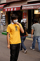 montreal  (QC) CANADA - Sept  2009 - model released photo of an asian teenage male wearing a mask designed to prevent spreading viruses such as H1N1 flu.
