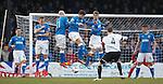 Ayr's Scott McLaughlin tries to fire the ball under thr Rangers wall