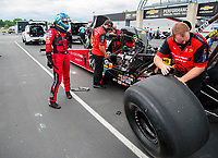 Jul 19, 2020; Clermont, Indiana, USA; Crew members change a tire on the dragster of NHRA top fuel driver Leah Pruett during the Summernationals at Lucas Oil Raceway. Mandatory Credit: Mark J. Rebilas-USA TODAY Sports