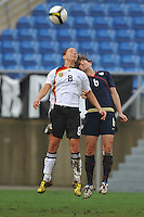 US defender #6, Amy LePeilbet goes up for a header vs Germany in the 2010 Algarve Cup Final in Faro, Portugal. The US won 3-2.