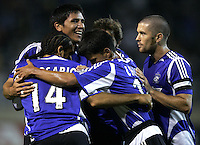 21 September 2005: Brian Ching of the Earthquakes smiles while celebrating with Dwayne De Rosario, Brian Mullan, Mark Chung and Wade Barrett after Rosario scored a goal during the first half of the game at Spartan Stadium in San Jose, California.   San Jose Earthquakes leads Chicago Fire, 1-0 at halftime.