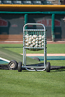 A cart full of baseballs sits at the end of batting practice as the Salt Lake Bees prepared to play the Sacramento River Cats in Pacific Coast League action at Smith's Ballpark on April 20, 2015 in Salt Lake City, Utah.  (Stephen Smith/Four Seam Images)