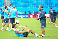Diego Lugano of Uruguay takes part in training away from the main group as he continues his recovery from injury ahead of tomorrow's Group D fixture vs Italy