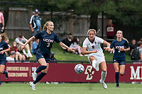 NEWTON, MA - AUGUST 29: Laura Gouvin #8 of Boston College passes the ball as Sofia Weber #3 of University of Connecticut defends during a game between University of Connecticut and Boston College at Newton Campus Soccer Field on August 29, 2021 in Newton, Massachusetts.