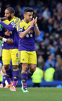 Pictured: Neil Taylor of Swansea thanks away supporters. Sunday 16 February 2014<br /> Re: FA Cup, Everton v Swansea City FC at Goodison Park, Liverpool, UK.