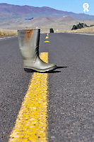 Old rubber boot on the middle of a highway, Old rubber boot on the middle of a highway, Mauna Kea volcano, Big Island, Usa (Licence this image exclusively with Getty: http://www.gettyimages.com/detail/85985780 )