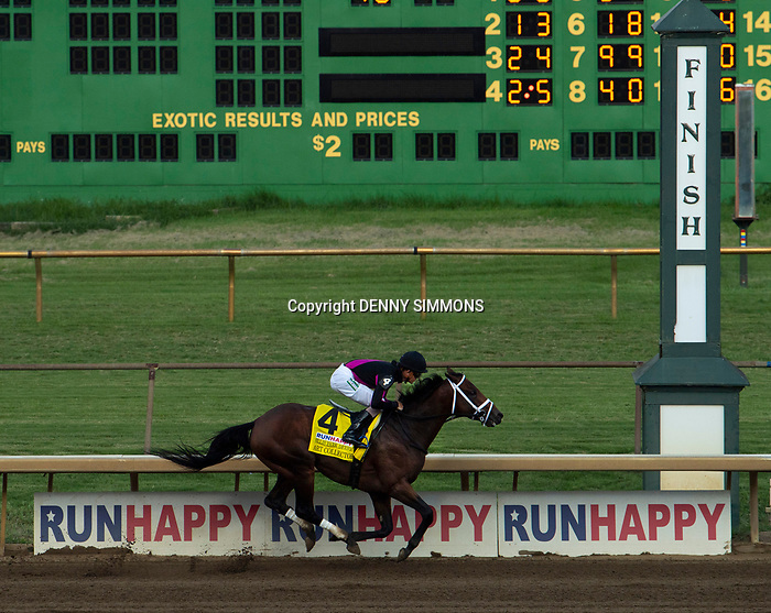 Art Collector, ridden by jockey Brian Hernandez Jr., nears the finish line of the Runhappy Ellis Park Derby's 10th race for a $200,000 purse at Ellis Park in Henderson, Ky., Sunday afternoon, Aug. 9, 2020. Art Collector won the race handily. The race is a qualifier for the upcoming Sept. 5, 2020, Kentucky Derby, with 85 points (50-20-10-5) up for grabs.