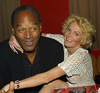 EXCLUSIVE<br /> Miami Beach, FL 2-7-02<br /> OJ Simpson and friend Tammy Wu<br /> enjoy a night out at KISS Restaurant.<br /> Photo by Adam Scull/PHOTOlink