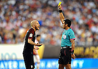 Philadelphia, PA - June 11, 2016: USA midfielder Michael Bradley (10) and REF. Julio Bascuñán during a Copa America Centenario Group A match between United States (USA) and Paraguay (PAR) at Lincoln Financial Field.