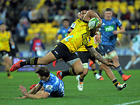 Hurricanes' Ngani Laumape hurdles Matt Duffie during the Super Rugby Aotearoa match between the Hurricanes and Blues at Sky Stadium in Wellington, New Zealand on Saturday, 18 July 2020. Photo: Dave Lintott / lintottphoto.co.nz