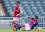 Yuto Nakamura of SCAA (L) competes for the ball with (R) Matthew Tomas Lam of Kitchee during the HKFA Premier League between South China Athletic Association vs Kitchee at the Hong Kong Stadium on 23 November 2014 in Hong Kong, China. Photo by Aitor Alcalde / Power Sport Images