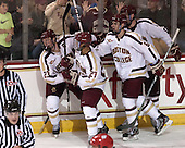Patrick Brown (BC - 23), Quinn Smith (BC - 27), Steven Santini (BC - 6), Ian McCoshen (BC - 3) - The Boston College Eagles defeated the visiting University of Wisconsin Badgers 9-2 on Friday, October 18, 2013, at Kelley Rink in Conte Forum in Chestnut Hill, Massachusetts.