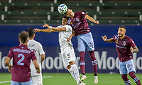 CARSON, CA - SEPTEMBER 19: Joe Corona #15  of the Los Angeles Galaxy battles with Cole Bassett #26 of the Colorado Rapids during a game between Colorado Rapids and Los Angeles Galaxy at Dignity Heath Sports Park on September 19, 2020 in Carson, California.