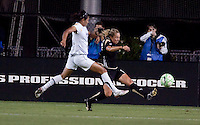 Kristen Graczyk (right) kicks out the ball against Han Duan (right). FC Gold Pride tied the Los Angeles Sol 0-0 at Buck Shaw Stadium in Santa Clara, California on July 23, 2009.