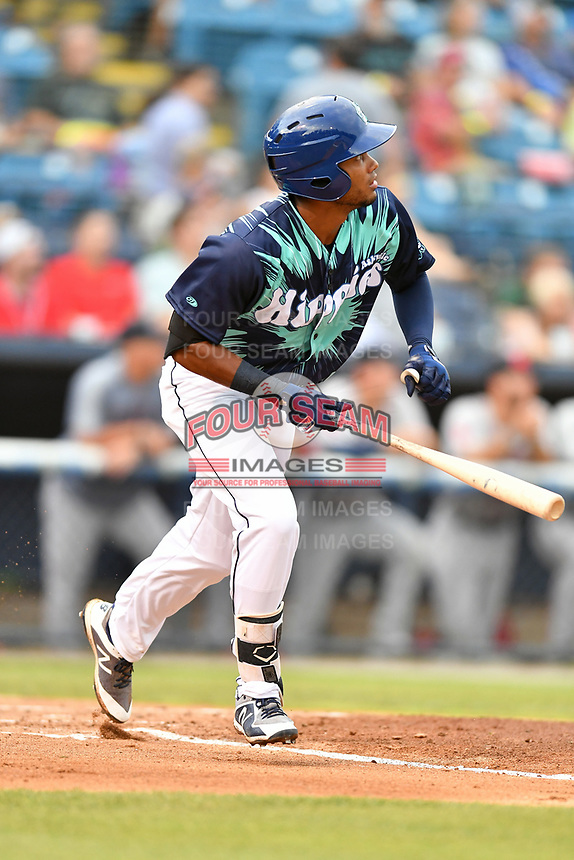 Asheville Tourists Daniel Montano (24) runs to first base during a game against the Greenville Drive on Hippie Night at McCormick Field on July 11, 2019 in Asheville, North Carolina. The Drive defeated the Tourists 6-2. (Tony Farlow/Four Seam Images)