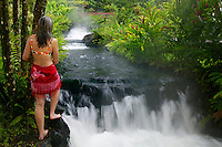 A visitor (mr) enjoys a hot water stream flows through Tabacon Hot Spring Resort and Spa, Costa Rica