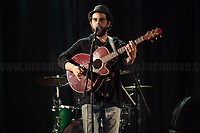 """Prologue: Nosenzo's Sound Check.<br /> <br /> Rome, 14/04/2018. Today, the """"Nuovo Cinema Palazzo"""", to celebrate the 7th anniversary of its occupation, held a concert with various bands, including """"Nosenzo"""" (Alessandro Nosenzo: lead singer, songwriter, guitar; Giulia Anita Bari: violin; Renato Gattone: contrabass / double bass - https://www.renatogattone.net/; Nicolò Di Caro: Drums; <<Mediterranean Sound and Gypsy Heart, Nosenzo embraces different styles and historical periods for his music, looks to the East and embraces the earth. His music is a mixture of cultures and gives way to dances watching the world as a beautiful playground […]>>). From the organiser website: <<On the 15 April 2011, citizens, movements, workers of the entertainment industry reopened the former """"Palazzo Cinema"""" to prevent the opening of a casino. The project, which was without authorization and strongly illegitimate, would have involved the San Lorenzo's area and its urban and social community. It was against the 'construction' of gambling and the rampant speculation from which the project of the Nuovo Cinema Palazzo was born, now that is the place of the 'possible' in which art, culture and politics constantly take shape and content. [...] Where decisions are made focusing on the relationship and the meeting between people there is always an open place for exchange, discussion and sharing. Every moment in which it is decided to resist opens a different horizon capable of creating a cultural, political and social space accessible to everyone. Every form of material and immaterial work which is practised is the collective will that gives back  quality as well as quantity, at the same time enhancing aesthetics and beauty [...] >>.<br /> <br /> For more info please click here: http://www.nuovocinemapalazzo.it/ & https://bit.ly/2H0QBqb<br /> <br /> For More info about Nosenzo please click here: https://bit.ly/2H0nOSM & https://bit.ly/1IFlc6P & https://bit.ly/2qztM1T & https://bit.ly/2qAhqYe"""