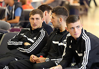 Wednesday 28 August 2013<br /> Pictured L-R: Players Ben Davies, Lee Lucas and Rory Donnelly at Cardiff Airport.<br /> Re: Swansea City FC players and staff en route for their UEFA Europa League, play off round, 2nd leg, against Petrolul Ploiesti in Romania.