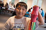 A Chines boy holds up a paper lantern that he made at the Chinese Lantern Festival, hosted by the Chinese American Museum at El Pueblo de Los Angeles Historic Site in Downtown Los Angeles, CA
