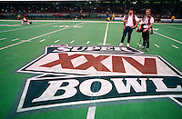 NEW ORLEANS, LA - Photographers Brad Mangin and Jon McNally pose on the field after Super Bowl XXIV between the Denver Broncos and San Francisco 49ers at the Louisiana Superdome in New Orleans, Louisiana on January 28, 1990. Photo by Brad Mangin.