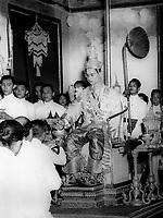Bhumibol at his coronation at the Grand Palace., wearing the Great Crown Victory.
