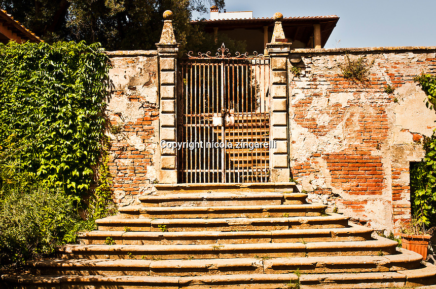 This is the entrance of an old house in Villa Saletta in the county of Pisa, Italy. Probably the only inhabited building in the abandoned village