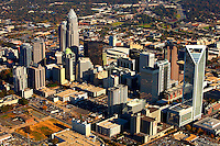 Aerial photography of downtown / uptown / center city Charlotte, NC, by photographer Patrick Schneider. Photos taken in November 2009 to show the newest skyscrapers that have appeared in the southern city's skyline, including the Duke Energy Center, a 764-foot tall, 49-floor skyscraper (54 floors total with mechanical floors) completed in 2009. Charlotte is the largest city in North Carolina and the seat of Mecklenburg County. An estimated 687,500 people live in Charlotte, making it one of the 20 largest cities in the country.