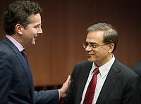 Eurogroup President Dutch Finance Minister Jeroen Dijsselbloem (L) talks with Greek Finance Minister Gikas Chardouvelis   at the start of a Eurogroup with European Finance Ministers meeting at EU council headquarters in Brussels, Belgium on 26.01.2015 The Eurogroup's meeting focus on Greece, after  leftist anti-bailout party SYRIZA won parliamentary elections by Wiktor Dabkowski