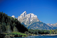 Grand Tetons with trees & Snake River in foreground. Grand Teton National Park Wyoming USA.