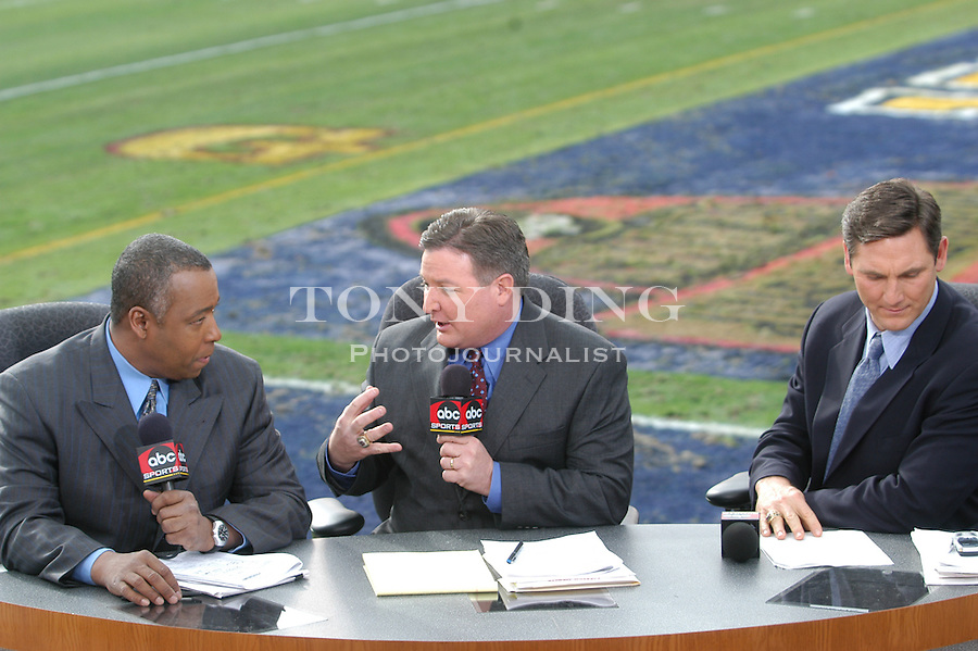 ABC Sports announcers John Saunders, Terry Bowden, and during the Wolverines' 14-28 loss to USC on Thursday, January 1, 2004 at the Rose Bowl in Pasadena, California. It was Michigan's 18th appearance at the Rose Bowl and the 90th game the bowl has played. (TONY DING/The Michigan Daily)