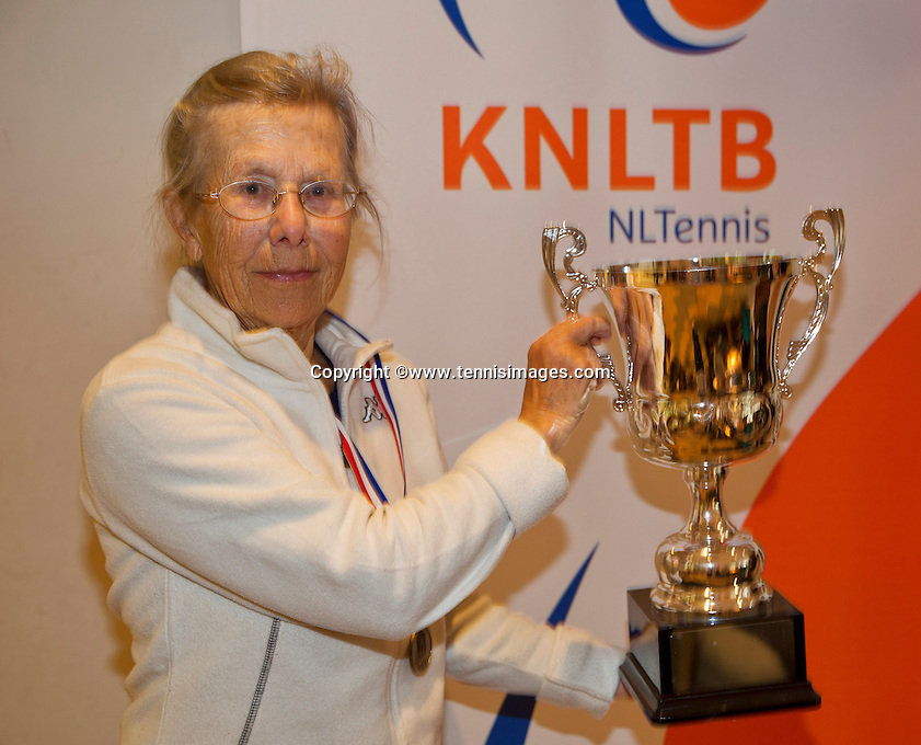 March 5, 2015, Netherlands, Hilversum, Tulip Tennis Center, NOVK, Final Lady's 80+ , winner Bea Nerden (NED) with the trophy<br /> Photo: Tennisimages/Henk Koster