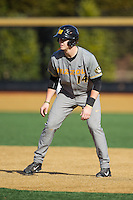 Zach Lavy (14) of the Missouri Tigers takes his lead off of first base against the Radford Highlanders at Wake Forest Baseball Park on February 21, 2014 in Winston-Salem, North Carolina.  The Tigers defeated the Highlanders 15-3.  (Brian Westerholt/Four Seam Images)