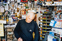 BNPS.co.uk (01202 558833)<br /> Pic: RayFisher/BNPS<br /> <br /> Pictured: Ray at work in the 1990s.<br /> <br /> Tireless Ray Fisher still works full-time in the motorcycle shop he opened 62 years ago - and he has plenty left in the tank.<br /> <br /> The 85 year old founded Ray Fisher's Brickbits in Christchurch, Dorset, in 1959 after training as a bike mechanic.<br /> <br /> It is a family affair as his two children Gerry, 58, and Stephanie, 54, have both worked solely for him since leaving school aged 16.<br /> <br /> Ray said he had loved bikes since childhood and learnt how to repair them while doing national service in the early 1950s.