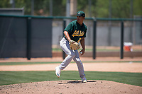 Oakland Athletics relief pitcher Jorge Martinez (61) delivers a pitch during an Extended Spring Training game against the San Francisco Giants Orange at the Lew Wolff Training Complex on May 29, 2018 in Mesa, Arizona. (Zachary Lucy/Four Seam Images)
