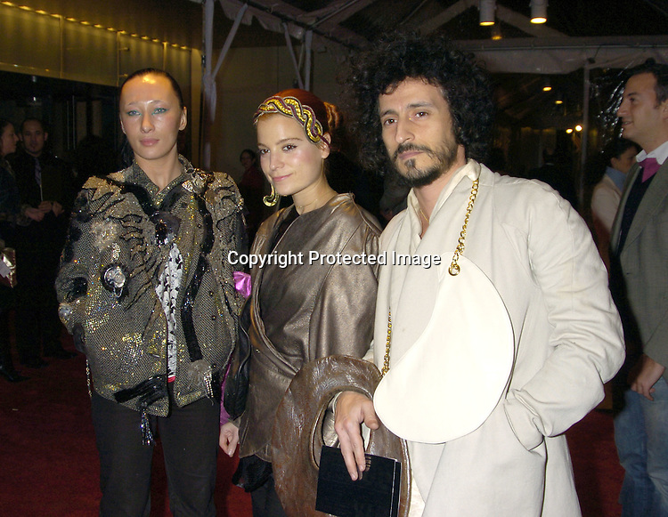As Four ..at the Re-opening party  for The Museum of Modern Art on ..November 18, 2004 in New York City. ..Photo by Robin Platzer, Twin Images