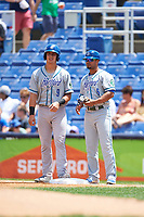 Hartford Yard Goats Dom Nunez (9) talks with Jan Vazquez (6) while on first base during a game against the Binghamton Rumble Ponies on July 9, 2017 at NYSEG Stadium in Binghamton, New York.  Hartford defeated Binghamton 7-3.  (Mike Janes/Four Seam Images)