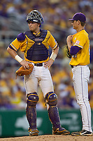 LSU Tigers catcher Ty Ross #26 visits with the pitcher during the NCAA Super Regional baseball game against Stony Brook on June 10, 2012 at Alex Box Stadium in Baton Rouge, Louisiana. Stony Brook defeated LSU 7-2 to advance to the College World Series. (Andrew Woolley/Four Seam Images)