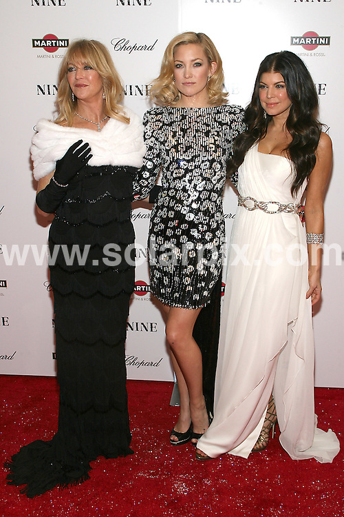 **ALL ROUND PICTURES FROM SOLARPIX.COM**.**SYNDICATION RIGHTS FOR UK, AUSTRALIA, DENMARK, PORTUGAL, S. AFRICA, SPAIN & DUBAI (U.A.E) ONLY**.arrivals for Nine, the New York Premiere at the Ziegfeld Theater, New York City, NY, USA. 15 December 2009..This pic: Fergie, Kate Hudson and Goldie Hawn..JOB REF: 10413 PHZ Gaboury  DATE: 15_12_2009.**MUST CREDIT SOLARPIX.COM OR DOUBLE FEE WILL BE CHARGED**.**MUST NOTIFY SOLARPIX OF ONLINE USAGE**.**CALL US ON: +34 952 811 768 or LOW RATE FROM UK 0844 617 7637**