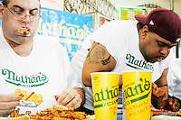 """""""Badlands"""" Booker, right, and Ed """"Cookie"""" Jarvis at the I.F.O.C.E. sanctioned World French Fry Eating Championship, in New York City on March 31, 2005."""