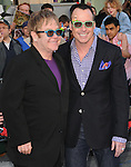 Elton John and David Furnish at Touchstone Pictures' World Premiere of Gnomeo & Juliet held at The El Capitan Theatre in Hollywood, California on January 23,2011                                                                               © 2010 DVS/Hollywood Press Agency