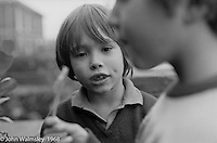 Admiring/envying another kid's lolly, Summerhill school, Leiston, Suffolk, UK. 1968.