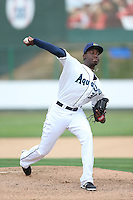 Enyel De Los Santos (30) of the Everett AquaSox pitches during a game against the Spokane Indians at Everett Memorial Stadium on July 24, 2015 in Everett, Washington. Everett defeated Spokane, 8-6. (Larry Goren/Four Seam Images)