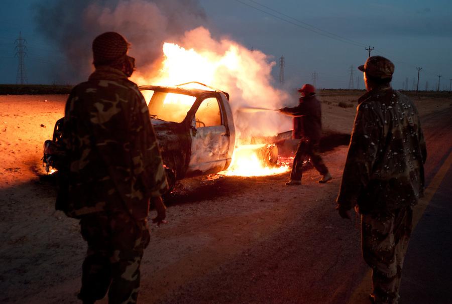 Truck burns side of the road between Ajdabiya and Benghazi, Libya.